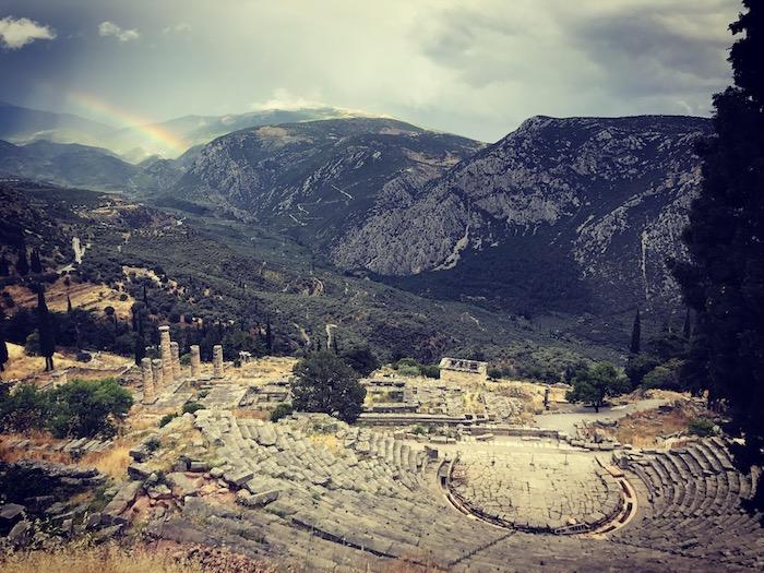 The Apollo Temple under a rainbow in Delfi, Greece