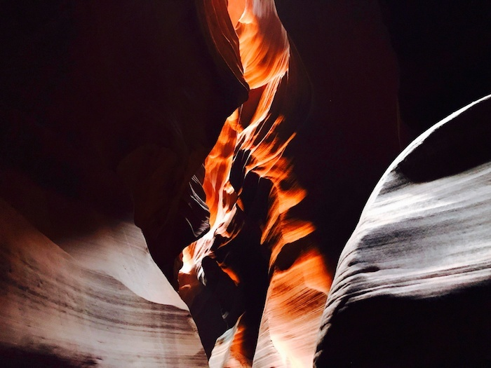 The light forms a dragon on fire on the Lower Antelope Canyon walls