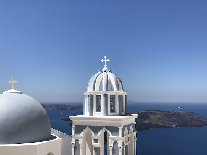 One of the many blue-domed churches near Firostefani, Santorini, Greece