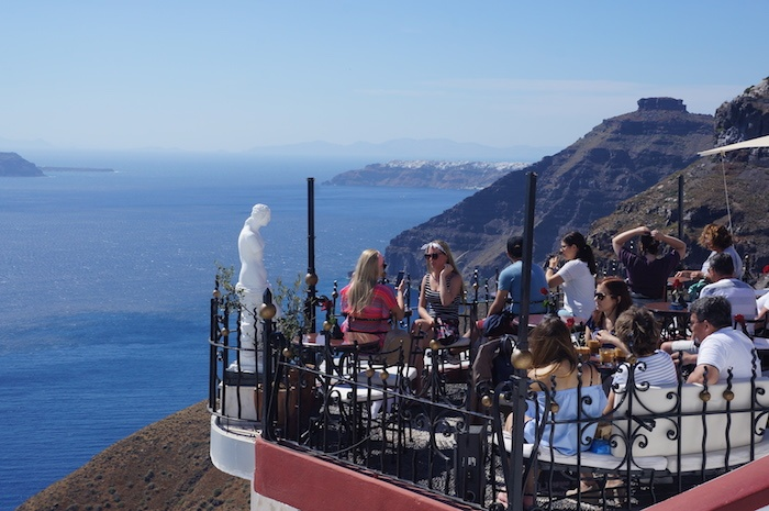 Enjoy the afternoon in one of the cliffside bars in Santorini